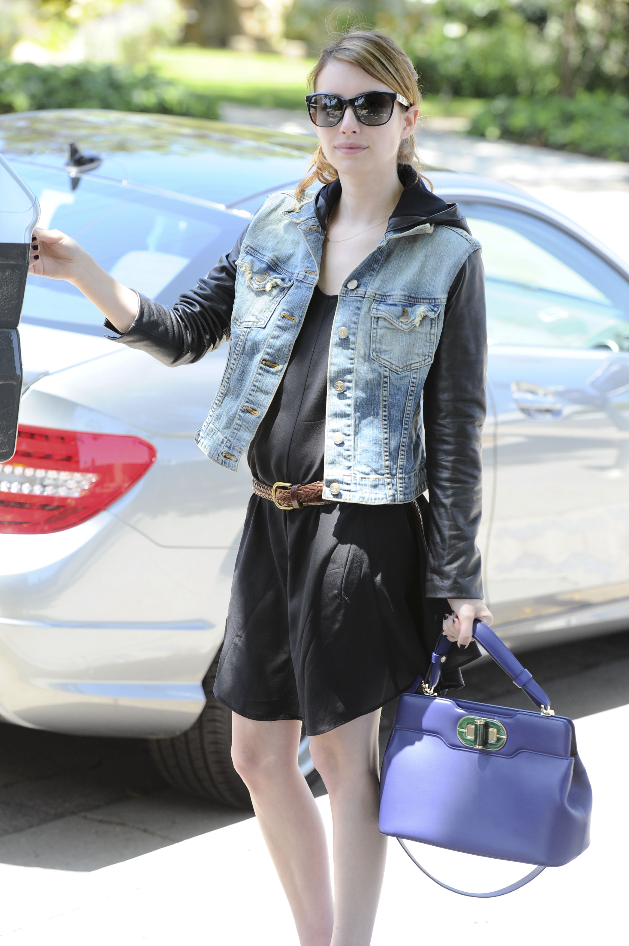 Emma Roberts in Bulgari bag and glasses